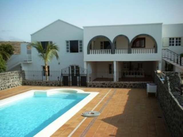 1 bedroom apartment in large Canarian villa Playa Honda, Lanzarote. Excellent views, heated pool, spacious, free airport pick ups, discounted car hire, same price all year round.